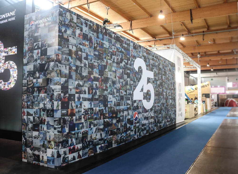 Main display wall at Outdoor 2018 trade show showing 25 Years campaign design