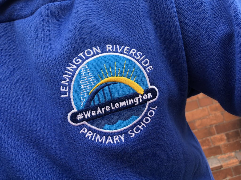 school jumper with new logo